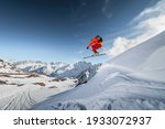 An Athlete Male Skier Jumps...