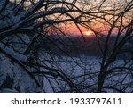 Winter Sunset Over The Frozen...