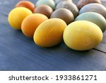 Easter eggs natural coloring on wooden background. Colorful Easter eggs collection. Shallow dof.