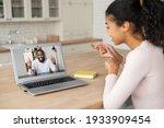 Woman Sitting At Table  At Home ...