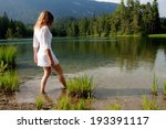 Young Woman Wading Through Water