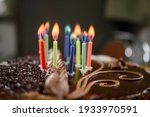 Small photo of Burning colored candles on a holiday cake, the child's tenth anniversary. new