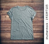 grey t shirt on wood background | Shutterstock . vector #193397105