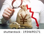 Small photo of Woman female manager examines a yen or yuan money bag with a red down arrow and automobile. Car insurance, taxes, maintenance. Fuel excise taxes. Electric vehicle support subsidies.