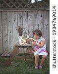 Eating Easter Eggs. Little Girl ...