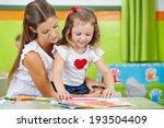 girl doing arts and crafts with ... | Shutterstock . vector #193504409