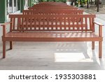 A Row Of New Wooden Benches...