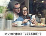embracing couple using mobile... | Shutterstock . vector #193538549