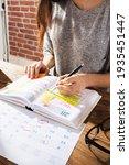 look at calendar schedule... | Shutterstock . vector #1935451447