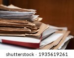 Small photo of Old yellowed manuscripts lie in a stack, beautiful paper background, there is place for text. A book typed on a manual typewriter was brought to the publishing house to publish a book