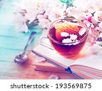 books  flowers and cup of tea... | Shutterstock . vector #193569875