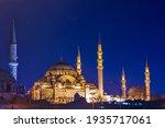 Suleymaniye Mosque with night illumination and minaret of Rustem Pasha Mosque, Istanbul, Turkey