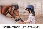 asian school kid girl with... | Shutterstock . vector #1935982834
