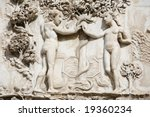 Small photo of Adam and Eve in the Garden of Eden in front of the tree of knowledge. Detail from the ornate of the facade - Orvieto Cathedral, Umbria, Italy