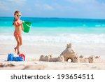 Little Girl At Tropical Beach...