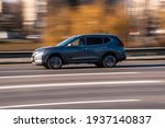 Small photo of Ukraine, Kyiv - 11 March 2021: Gray Nissan Rogue car moving on the street