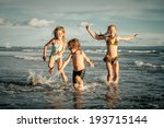 Happy Kids Playing On Beach In...