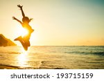 teen girl jumping on the beach... | Shutterstock . vector #193715159