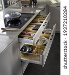 Small photo of Modern kitchen, Open drawers, Set of cutlery trays in kitchen drawer. Solid oak wood cutlery drawer inserts.