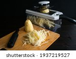 Small photo of Shredding Potatoes with a Mandoline: Using a mandoline to julienne russet potatoes