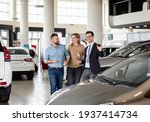 Young Car Salesman Showing To...