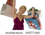 Glowing young blonde celebrating with shopping bags! - stock photo