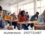 Small photo of Happy African American student raising her hand to ask a question during lecture in the classroom.
