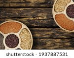 mix of legumes in wood bowl... | Shutterstock . vector #1937887531