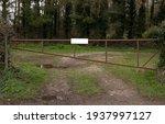 A Large Rusty Metal Gate Across ...