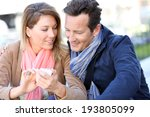 couple in town using smartphone | Shutterstock . vector #193805099