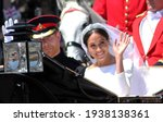 Small photo of Meghan Markle and Prince Harry wedding, Windsor, Uk - 19.5.2018: Prince Harry and Meghan Markle wedding carriage drives through streets of Windsor then back to Windsor Castle Meghan waving to crowd