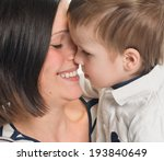 mother and her son embracing... | Shutterstock . vector #193840649
