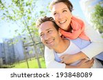 man giving piggyback ride to... | Shutterstock . vector #193848089