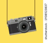 retro camera in a flat style... | Shutterstock .eps vector #1938523837