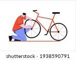 man checks a broken wheel on a...   Shutterstock .eps vector #1938590791