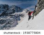 An Alpinist Climbing In Winter...