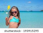 adorable little girl at white... | Shutterstock . vector #193915295