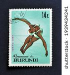 Small photo of Burundi - circa 1965 : Cancelled postage stamp printed by Burundi, that shows Diving and promotes Summer Olympic Games 1964 - Tokyo, circa 1965.