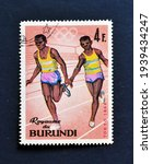 Small photo of Burundi - circa 1965 : Cancelled postage stamp printed by Burundi, that shows Relay Race and promotes Summer Olympic Games 1964 - Tokyo, circa 1965.