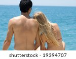 Man And Woman Sitting On Deck...