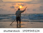 Fisherman Casting His Net At...