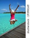 girl jumping on the beach   Shutterstock . vector #19398169