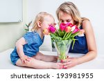 mother and daughter sniffing... | Shutterstock . vector #193981955