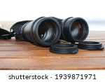 Front facing lenses of birdwatching binocular . Selective focus. Shallow depth of field