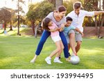 family playing soccer in park... | Shutterstock . vector #193994495