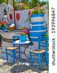 Iconic Blue Chairs And Table O...
