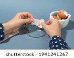 Women Hands Remowing Eggshell...