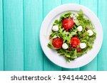 green salad made with  arugula  ... | Shutterstock . vector #194144204