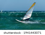 Windsurfing in the meltemi wind in Laguna beach south of the port of Naxos on the northwest coast of the Greek island of the same name in the Cyclades archipelago