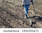 A Man With A Metal Detector In...